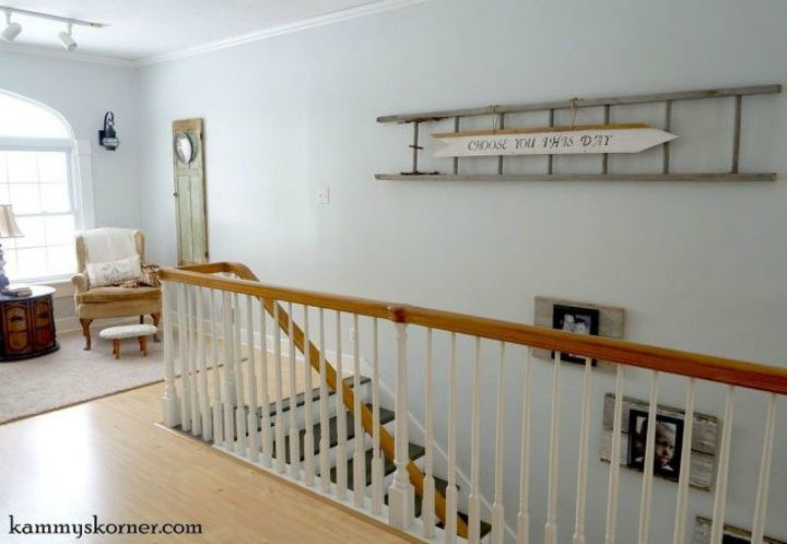 s if your stairway walls are empty here s what you re missing, A farmhouse style ladder decor