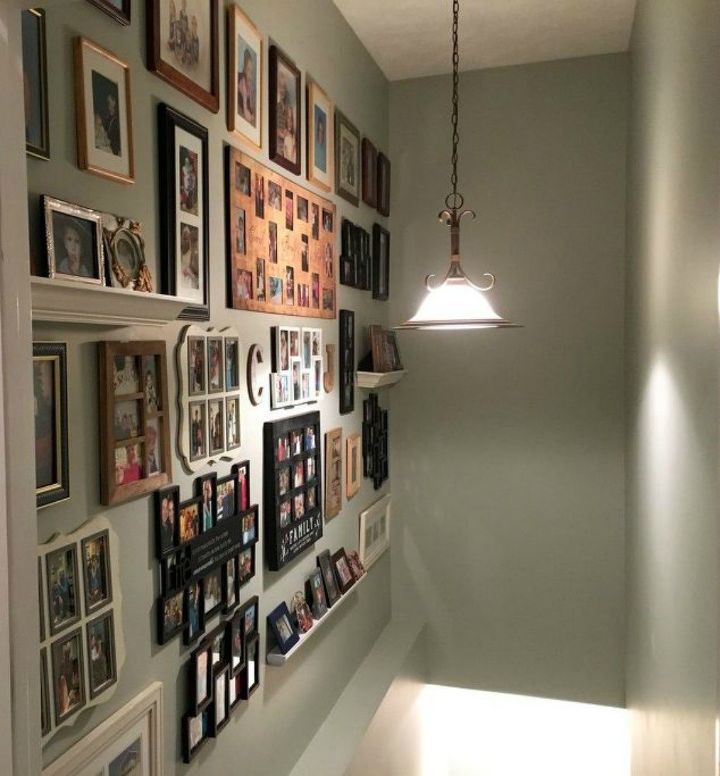 s if your stairway walls are empty here s what you re missing, A big gallery wall of family pictures