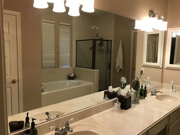 q how to you take down a huge builders grade bathroom mirror