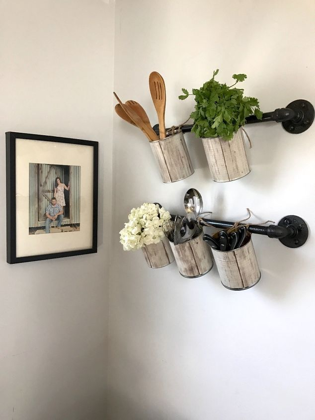 s 32 space saving storage ideas that ll keep your home organized, Craft Hangers For Herbs With Cans