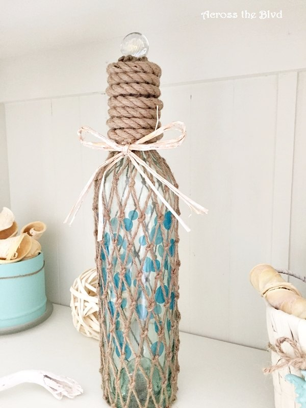 s 31 coastal decor ideas perfect for your home, Cover A Wine Bottle In Fishing Nets