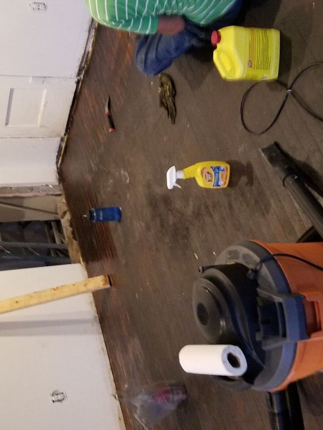 q removing adhesive residue from 70 year old wood floor