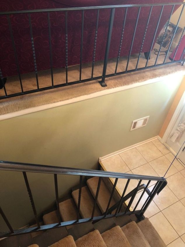 q painting iron rails in the house