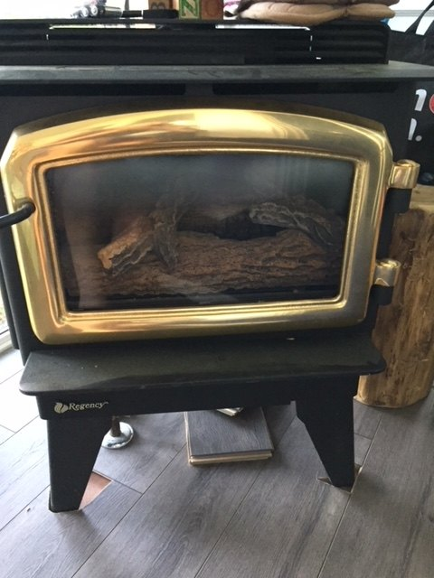 q how can i cover up cut out laminate around a gas woodstove s feet