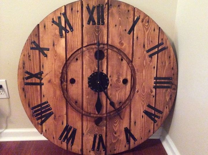 s 23 diy wall clocks you ll love, Rustic Cable Spool Wall Clock