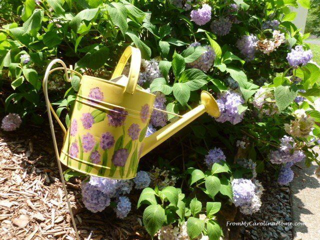 watering can garden art
