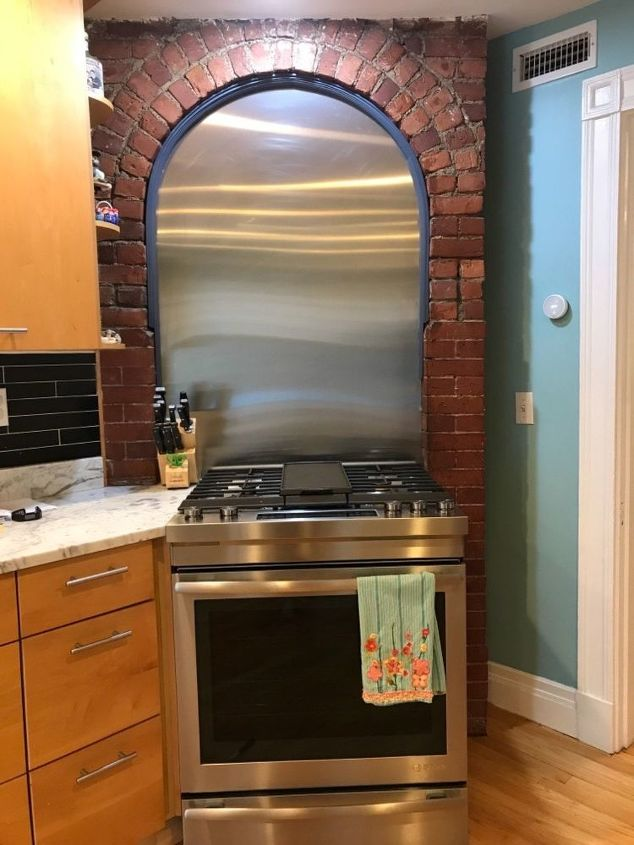 q any ideas on what to do with this odd space over my stove