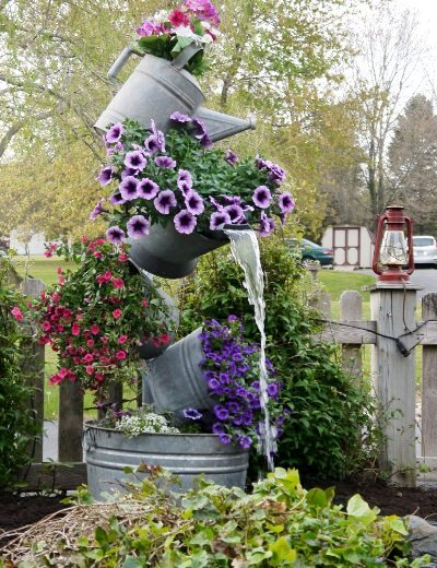 s 31 creative garden features perfect for summer, Stack flower filled buckets into a tower