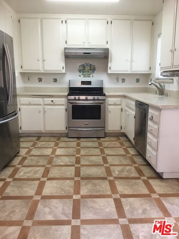 q how to cover ugly kitchen tiles in new home