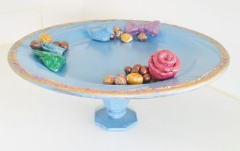 pastel colored cake dish with a gold edge sold at anthropologie