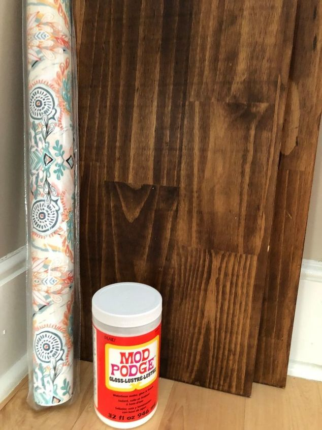 how i dressed up my wood wall shelf with mod podge and gift wrap
