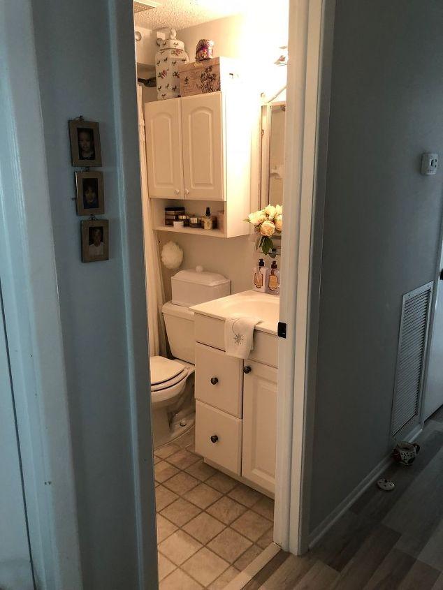 q how can i improve this tiny tiny bathroom