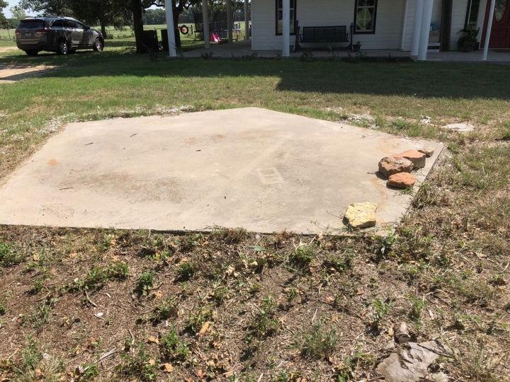 q how to landscape around this slab of concrete in my front yard