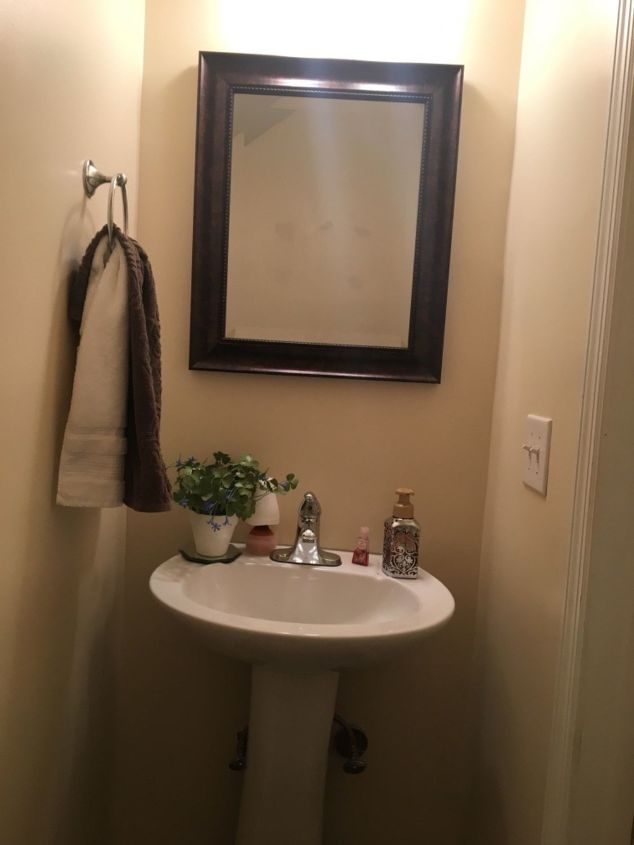 q how do i maximize the space in a tiny half bathroom