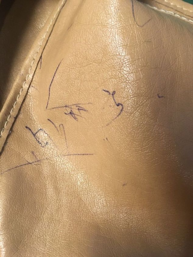 q how do i remove ball point ink from a leather purse