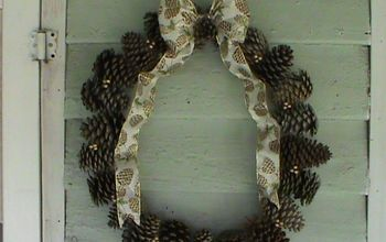 a simple autumn wreath of pine cones