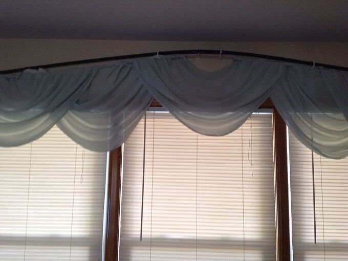 q how do i hang a floating curtain rod under a decorative rod