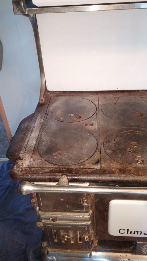 q how to clean an old wood burning stove in our cabin