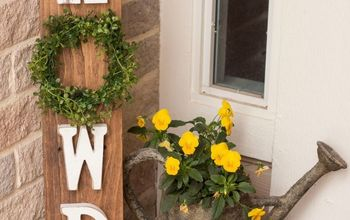 diy howdy pallet porch sign with interchangeable wreaths