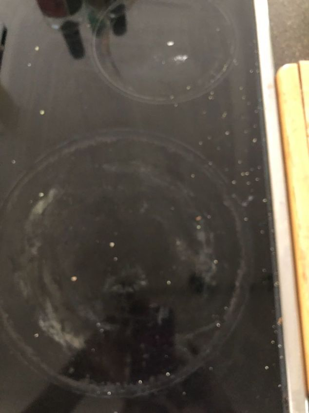 q how to clean an electric stove top