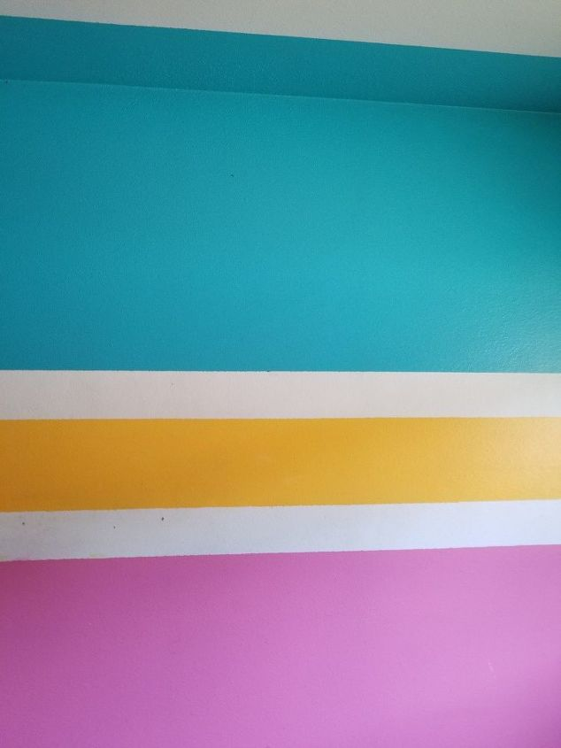 q how do i cover a wall with several layers of bright paint on a wall