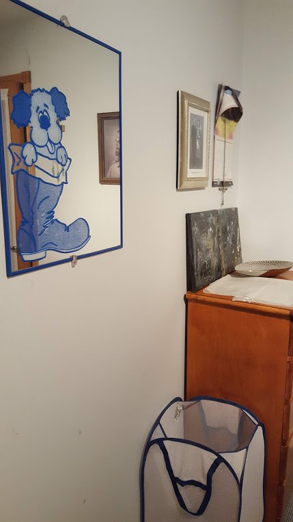 q how can i make this small guest bedroom work for my art room