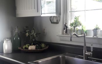 brighten your kitchen sink area with mirrors
