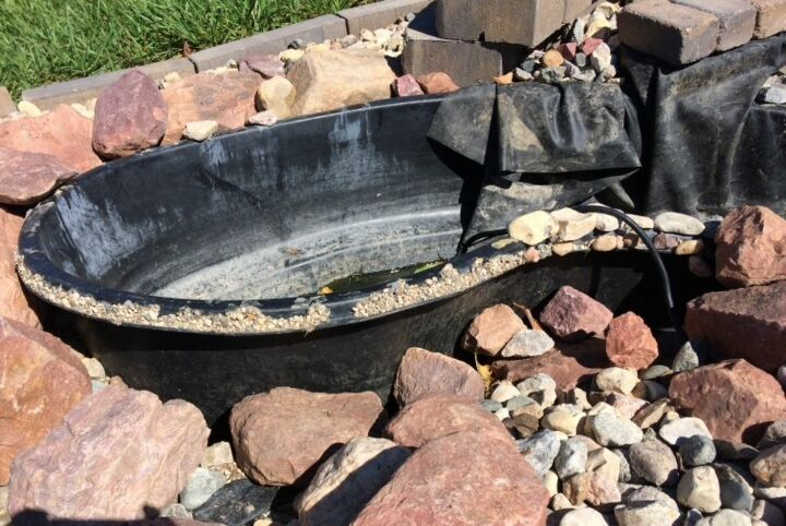 q i have a preformed pond i have put unground it keeps lifting up