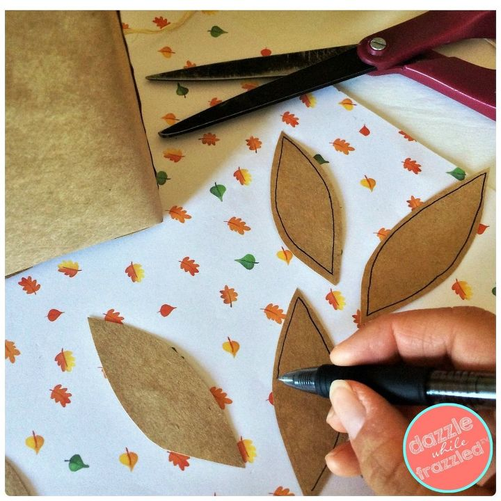 Cut out leaves from a brown paper grocery bag