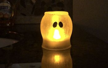 candle holder to etched ghost