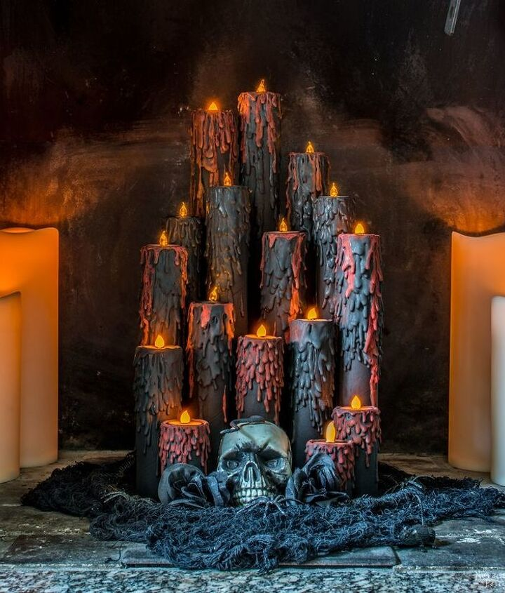 s 17 halloween decorations that ll make your neighbors giggle, Blood candles that ll make your guests scream