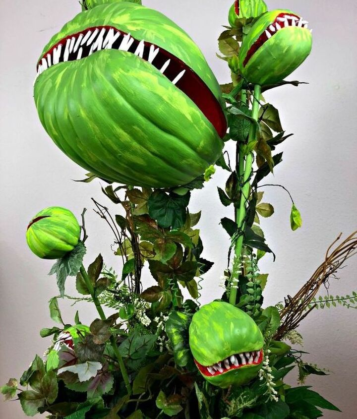 s 17 halloween decorations that ll make your neighbors giggle, Make a man eating plant for Halloween