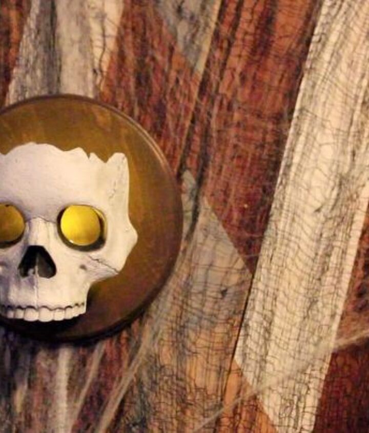 s 17 halloween decorations that ll make your neighbors giggle, DIY Dollar Store skull sconces
