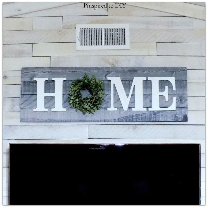 rustic wood home sign with a eucalyptus wreath