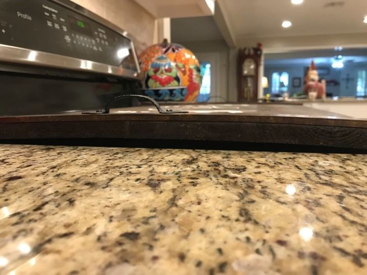 q how to repair warped wooden stovetop cover