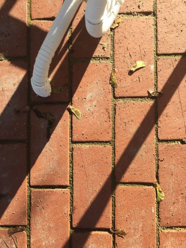 q how do i remove polymeric sandthat dried on our brick pavers