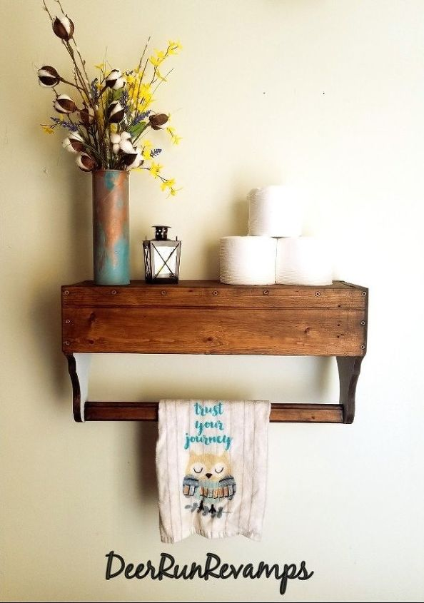 add trendy bathroom shelving using an old wooden toolbox