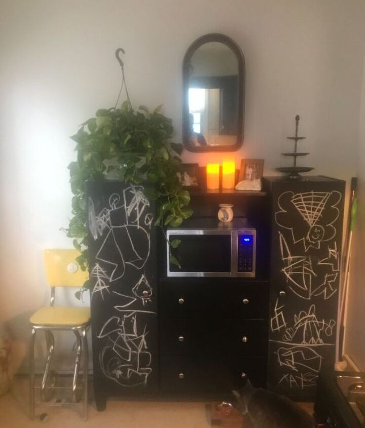 q added greenery to cabinet