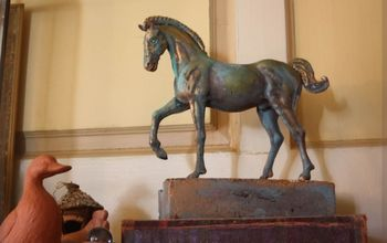 make a decorative horse sculpture, My bronze horse started as a plastic toy