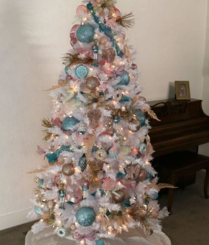 christmas tree decorating blue pink and gold ornaments