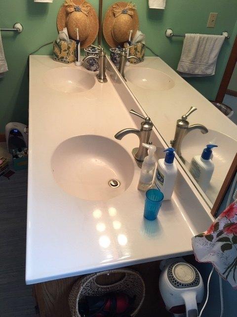 q how do i refurbish an older bathroom double sink in form vanity top