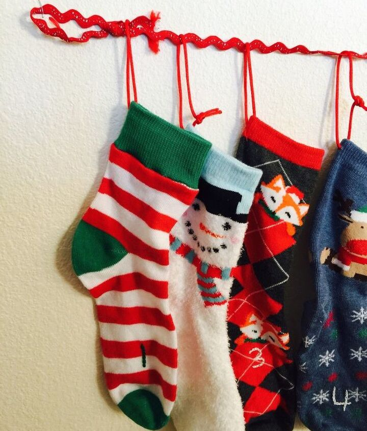 s 19 diy christmas decor ideas that ll rock your holiday, What about an adorable sock advent calendar