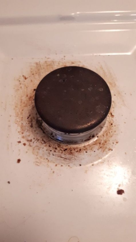 q how do i clean the surface of a gas stove surrounding the burners