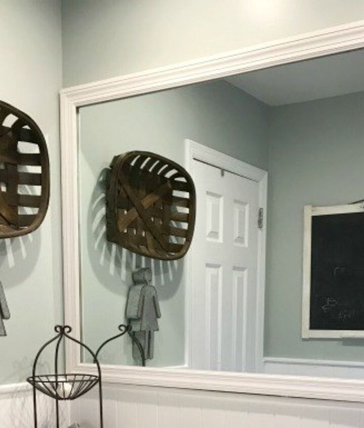 s 15 ways you can transform your bathroom for under 200, Add some charm and frame your mirror
