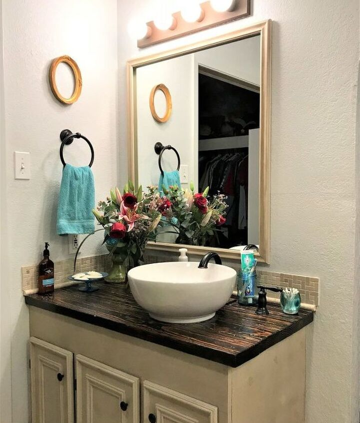 s 15 ways you can transform your bathroom for under 200, Add some cool lights