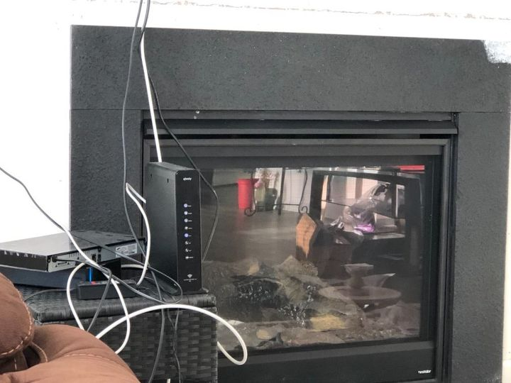 q how do i tile around my fireplace