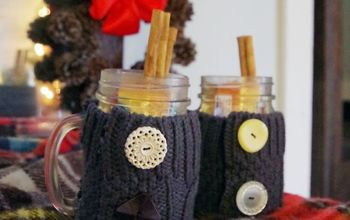 apple cider in a jar with a sweater koozie