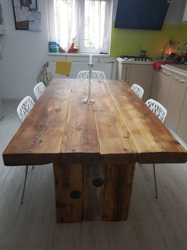 recycled old wood dining table and a chandelier