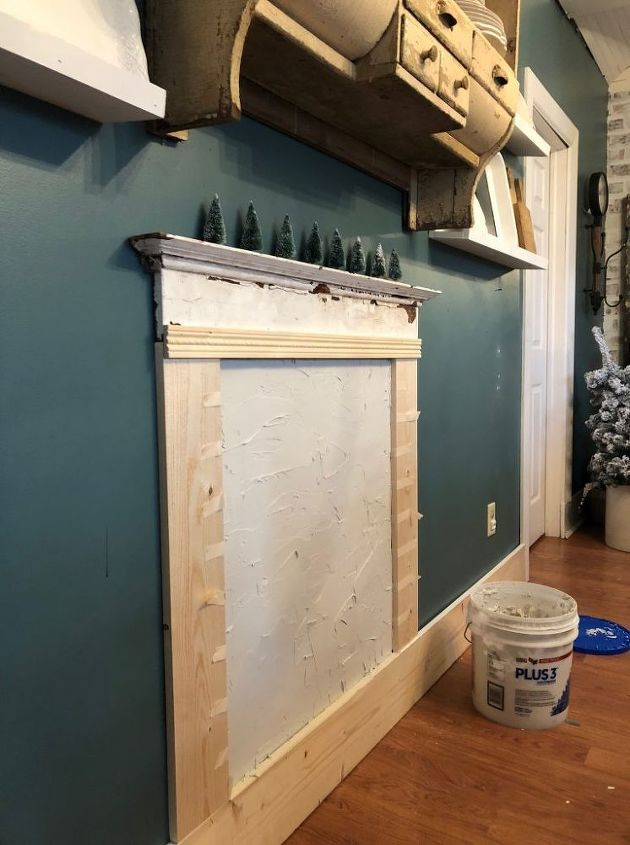 diy faux fireplace with faux brick chimney