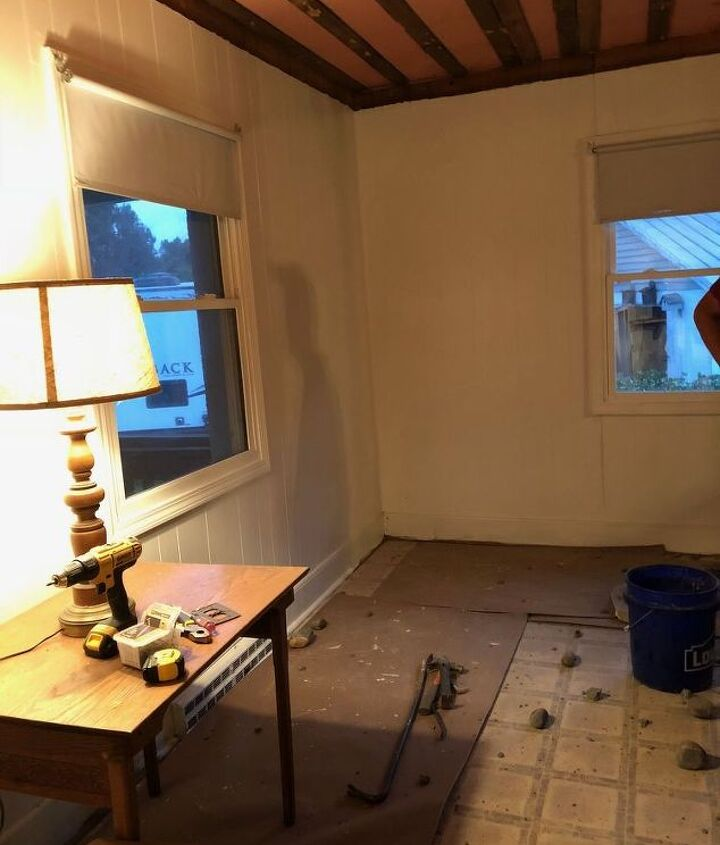 painting wood paneling opening up a wall in a small living room